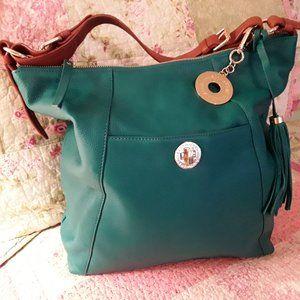 Beautiful, soft leather shoulder bag. Like Butter!
